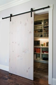 Simple whitewashed pine planks make a great barn door!