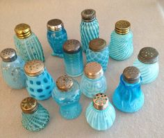 Collection of blue opalescent shakers and muffineers.