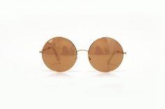 Óculos redondo com lente marrom