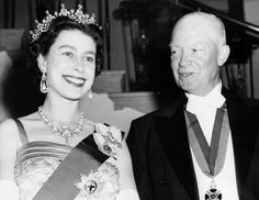 Queen Elizabeth II and U.S. Presidents Past and Present---President Dwight D. Eisenhower was the first sitting U.S. president to host Queen Elizabeth. Here she stands with Eisenhower at the White House State banquet he held in her honor on Oct. 20, 1957, in Washington. Eisenhower is wearing the British Order of Merit awarded him by King George VI after World War II. (Keystone/Getty Images)