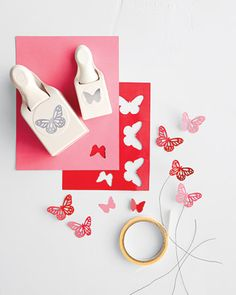 For Paper Butterfly Flower Arrangements - Use craft punches & paper to cut out butterfly shapes, attach to wire, and place in flower arrangement