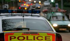 police car equipped with automatic number plate recognition cameras on patrol