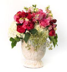 Beautiful floral arrangement from www.rogersgardens.com