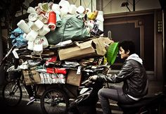 In China there is no official recycling policy or collection service. In big cities like Shanghai, Beijing or Guangzhou, you will see plenty of differentiated bins, but these are of little use as refuse collectors don't separate the rubbish. People such as this man make a living collecting plastic bottles, cardboard, metals and glass from the streets and selling it on to private recycling companies.