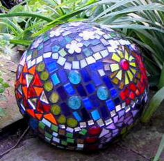 a recycled bowling ball.    Google Image Result for http://www.suesmithglass.co.uk/album/slides/A%2520recycled%2520bowling%2520ball.JPG