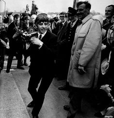 "Ringo on the set of A Hard Day's Night, 1964  David Hurn: ""This is me getting all post modern, taking a shot of Ringo who is filming with his camera, who is in turn being shot himself. There was a lot of ad-libbing on the film set and Ringo was often at the centre of this. He'd gone out and bought a camera himself to capture some of the events. He was quite an avid photographer. The lensmen behind him are a mix of genuine photographers and extras employed by Dick Lester."""