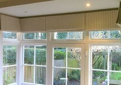 Dressing a square bay window is quite a challenge – but when positioned correctly, roman blinds can provide the perfect solution – rugcut Sunroom Window Treatments, Sunroom Windows, Window Coverings, Bay Windows, Sunroom Blinds, Bay Window Blinds, Blinds For Windows, Curtains With Blinds, Diy Curtains