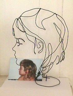 Wire portraits of children are a specialty of the artist, He can be reached at reagle@newsbyyou.info