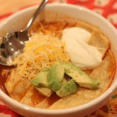 Crock Pot Chicken Tortilla Soup: chicken breast, diced tomatoes, onion, chilies, corn, garlic, chicken broth, cumin, cilantro, chili powder, pepper, enchilada sauce; cook on high for 4 hours; garnish with avocado, cheese, sour cream, and tortilla chips