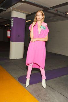 nude, fluo silk dress, flower broach, fluo skinny pants