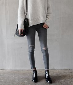 Grey jeans, sweater, Chelsea boots.