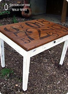 Give a plain Jane library table a more creative look by refinishing it and stenciling numbers of various fonts and sizes on top.