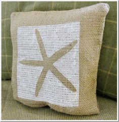 "<a href=""http://www.domestically-speaking.com/2011/04/69th-power-of-paint-party-painting.html"" target=""_blank""><strong>Painted Starfish Burlap Pillow from Domestically Speaking</strong></a>"