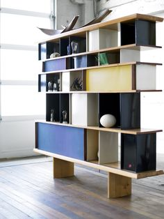 Charlotte Perriand bookshelf by Ateliers Jean Prouvé. I just love this shelf design.