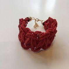 Red beaded bracelet Brand new in packaging. Lobster claps. Metal is alloy. Length is adjustable Jewelry Bracelets