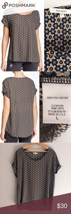 """💥SALE! Pleione Short Sleeve Blouse Super cute geometric print tee by Pleione.  Top has a scoop neck and slight hi-lo hem. Approximately 26"""" at shortest length, 27.5"""" at longest length. 100% polyester. Made in USA. Only worn once and in perfect condition. There is no give in the material and it was too snug on my super broad shoulders. It has a nice oversized fit to it though and looks great with skinny jeans or leggings! Pleione Tops Blouses"""