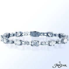 Style 0689 Beautifully crafted this exquisite bracelet features perfectly matched oval and round diamonds set in pure platinum.