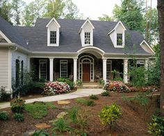 cape cod style......MY DREAM HOME! I LOVE THE ARCHED DOORWAY, THE DORMER WINDOWS NEED TO BE WIDER AND IT NEEDS A WRAP AROUND PORCH...THEN IT WOULD BE PERFECT!