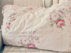Any linen, fabric or pillow with pink roses on a soft pink or white background makes me happy !
