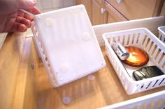 Put velcro stickers in your drawers and on the bottom of your drawer organizers to keep the baskets from sliding around.