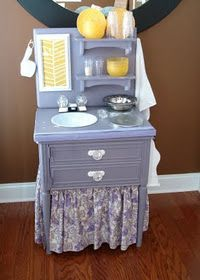 Kids kitchen out of an old dresser! You can go to a thrift store, buy a cheap night stand, take some paint, fabric, indent a small bowl for the sink, and add some hooks for utensils. So much more unique than those plastic kitchens!