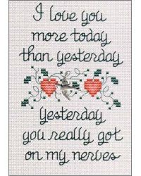 "This is cute. I want to make it for James to put in his office. People will look at it and think ""how lame, that dude has a cross stitch saying in his office."" Then they'll see that it's sassy."