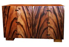The natural wood markings on this buffet are dramatically striking. Acacia wood doors with dovetail joints; removable shelf inside.  from Asian Art Imports on OKL