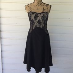 WHBM Lace Dress: Lovely! This dress whispers in the breeze while making you look like a bad mammajamma! Mesh style lace with Swiss dots, traditional lace and corset styling. Black cocktail dress. Lightly boned with moulded cups. Fully lined. Shows some use but no damage. Super flattering. Size 6, true to size as Blanche (my dress form) is a perfect size 6. White House Black Market Dresses Strapless