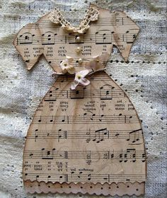 Paper Doll Dresse - 20  Clever and Cool Old Book Art Examples, http://hative.com/old-book-art-examples/,