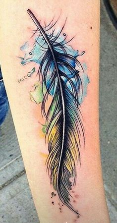 Feather watercolor tattoo, I'm absolutely in love with this! I need to find a tattoo artist who knows how to do a watercolor tattoo....
