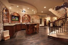 Lower level wet bar and recreation/media room.
