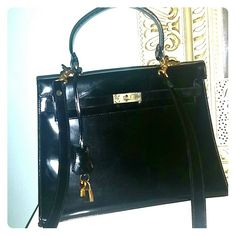 VINTAGE HENRI BENDEL BLACK PATTEN LEATHER BAG A classic bag from New York's flagship store circa 1990. Comes with little lock and key. Gold hardware.  It does have a few faint scratches and the inside flap has some peeling surface. But a beautiful piece. Henri Bendel Bags Satchels