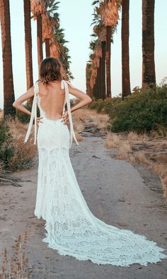 "The ""O'Keeffe"", a new spin off of our usual backless lace bohemian wedding dresses, is possibly as romantic as it gets. Beginning with a nude charmeuse"