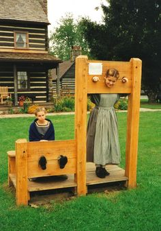 Kelly and Laura locked in the stocks and pillory.