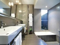Modern bathroom design with recessed bath using tiles - Bathroom Photo 435306