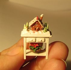 Gingerbread house on table with poinsettia, quarter scale