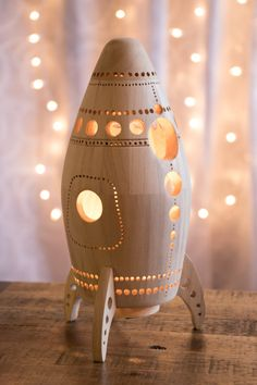 This wooden rocket ship lantern is perfect for an outer space themed nursery or childs bedroom. Its glow is bright enough to light the way in the
