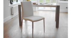 The elegant Elise Dining Chair is available in a range of luxurious faux leather colours: Black, Cream, Brown, Latte Beige, Poppy Red, Ruby Red and White. The seat is supported by slender and sleek polished chrome legs. £79.00