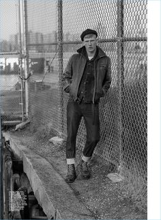 Sporting a workwear inspired look, Connor Newall appears in an editorial for Summerwinter.