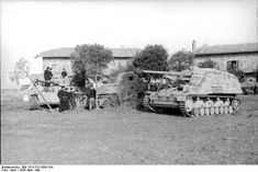 German Tiger I heavy tank and Hornisse/Nashorn tank destroyer in Italy, Apr-May 1944; note disabled American M4 Sherman medium tank between them; Photographer: Vack; Source: Bundesarchiv; ID: Bild 101I-313-1004-10A