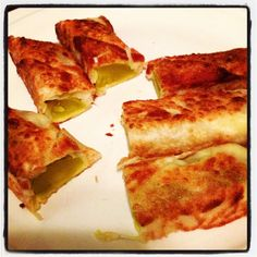 Fried pickles and havarti cheese in egg roll wrappers! Deelish
