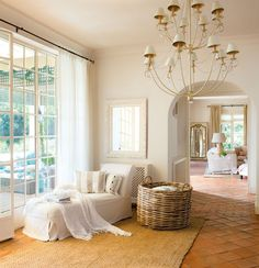 Traditional Family Room with picture window, Wisteria oversized seagrass basket, Paint, terracotta tile floors, Chandelier