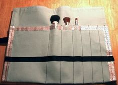 placemat turned into carrying case for brushes, pencils, crayons (for the kiddos) with little notepad...
