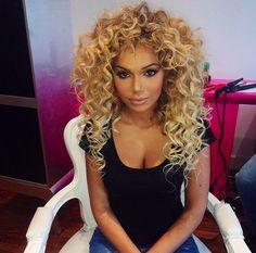 Curls. Big hair.