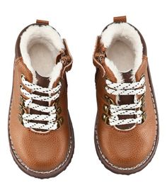 Baby Boy Size 4m-2y / £9.99 Imitation leather shoes with decorative laces and a zip and velcro fastener at the side. Pile lining and rubber soles.