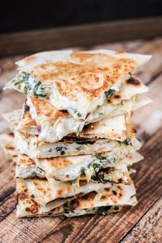 Spinach & Artichoke Quesadillas are full of baby spinach, artichoke, and CHEESE! Ooey, gooey and majorly delicious!
