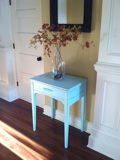 Vintage sewing machine cabinet painted blue, welcoming feel my grand entry.