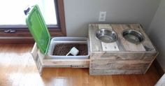 Dog bowl riser with storage drawer.
