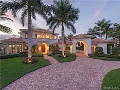 2569 Escada, Naples, FL 34109 | Mediterranean golf estate home in Tiburon - two story - porte cochere with iron gate - tropical - palm trees