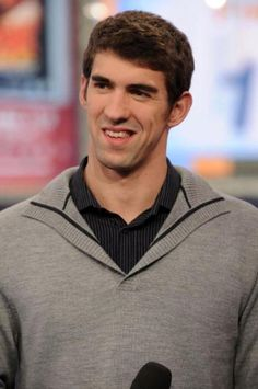 Michael Phelps, he's just so cute with that crooked smile
